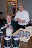 Margaret and Barbara stuffing CDs